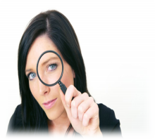 lady-holding-magnifying-glass